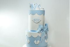 Blue booties baby shower cake