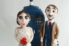 Belle and Dr Who bride and groom sugar figurines
