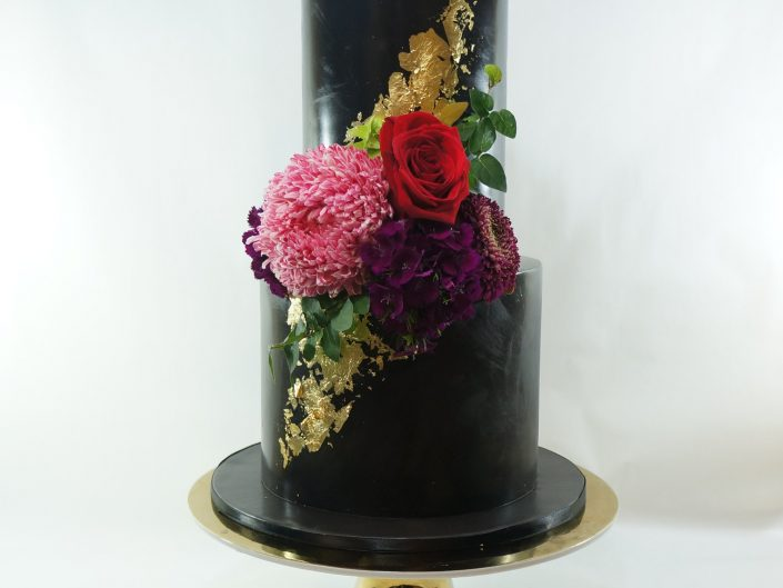 Black tower with scattered gold leaf